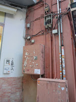Contaminación visual en BIC Centro Histórico de Málaga, cables