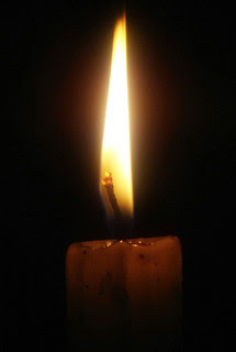 Candle by kkalyan via Flickr and a Creative Commons license