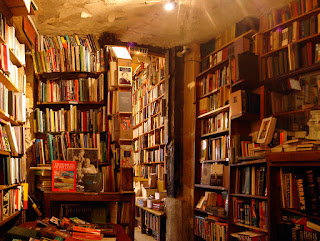 crammed bookshelves, Shakespeare and Company bookstore, Paris