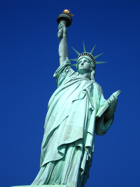 Beautiful blue sky behind the Statue of Liberty in New York City.