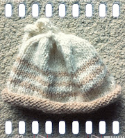 A baby hat knitted with 100% alpaca yarn