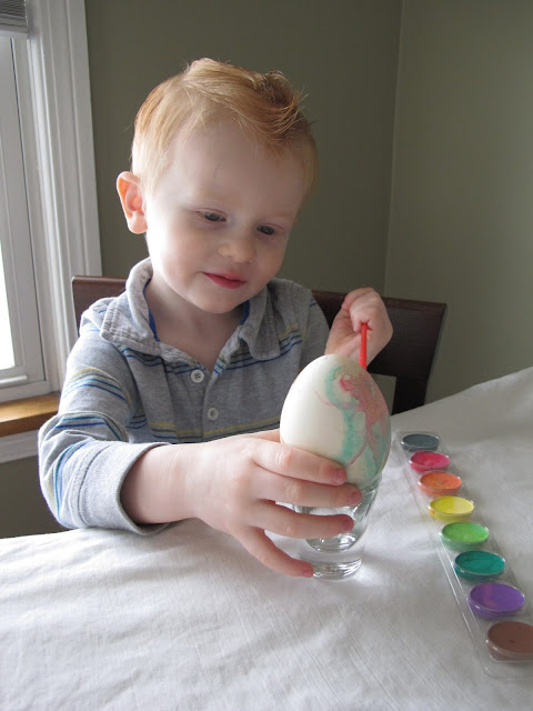 Porter Painting a Goose Egg