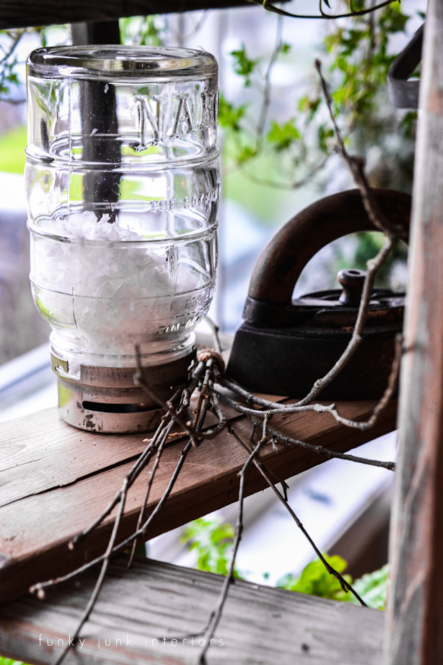 Vintage Nabob mason jar filled with snow, on a plant ladders stand, via Funky Junk Interiors
