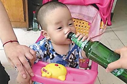 Gambar Bayi Minum Arak Timbulkan Kontroversi Di China