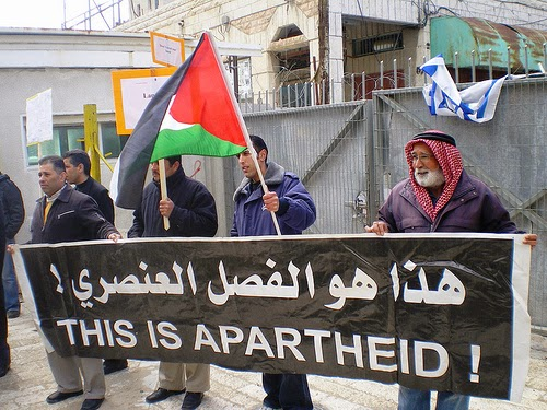 "Hebron demonstration against settlements and the marking of ""Land Day."" (Photo by ISM Palestine)"