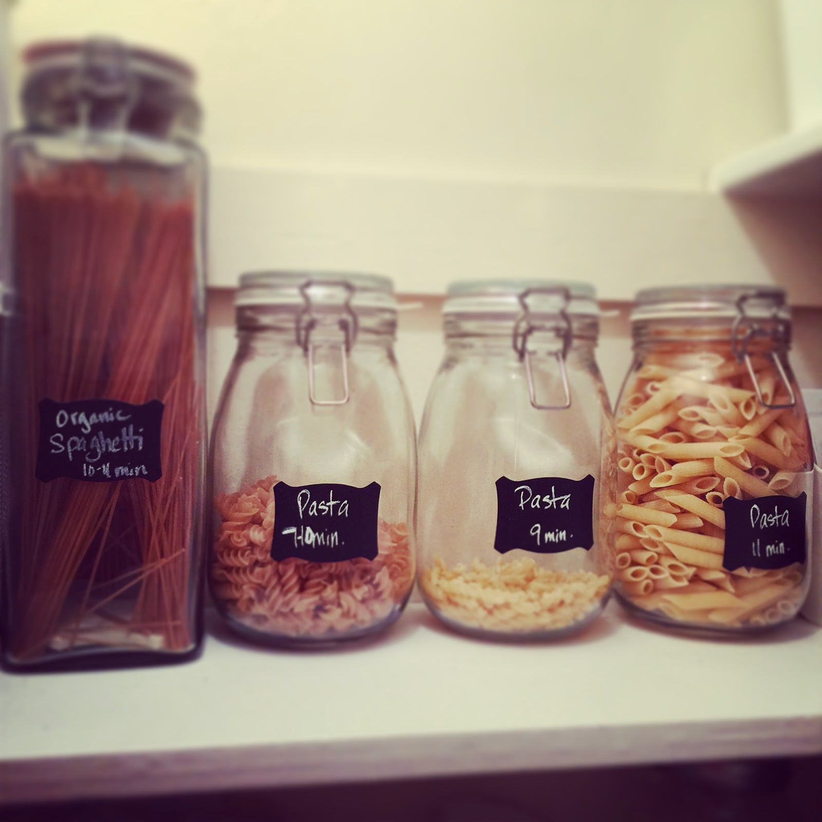 Label pasta jars with chalkboard labels and mark how long each cooks :: OrganizingMadeFun.com
