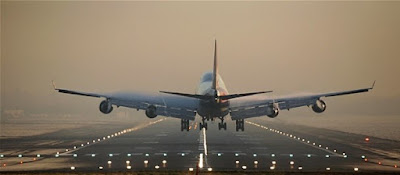 Evening photo of a plane taking off from Gatwick Airport