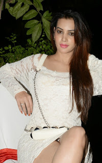 Actress Deeksha Panth Pictures in Short White Lace Dress at Bham Bolenath Audio Launch  76.jpg