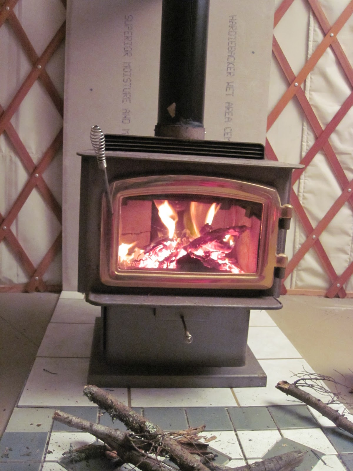 jay builds a house woodstove in a yurt