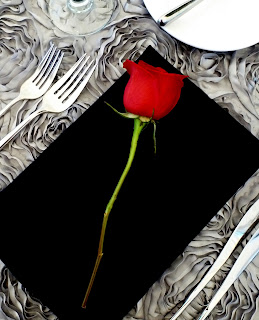 Black napkin and red rose table setting - Photo by Patricia Stimac, Seattle Wedding Officiant