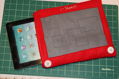 iPad in its Etch a Sketch cover
