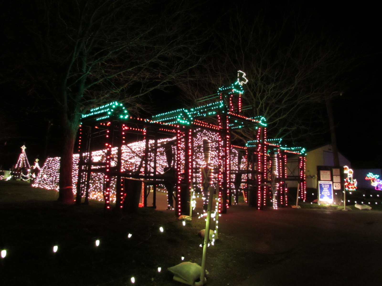 the display features a drive through area carriage rides and a walk through area with displays shops food vendors a campfire and lots of lights - Drive Through Christmas Lights Pa