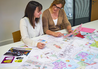 Hannah and Rachael going through the designs.