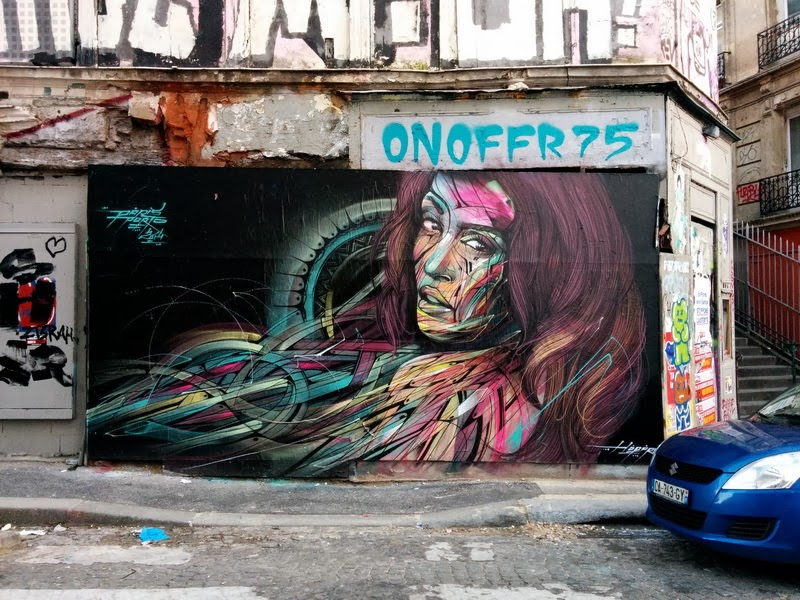 New Street Art Piece by French street artist Hopare in the 18th district of Paris, France. 1