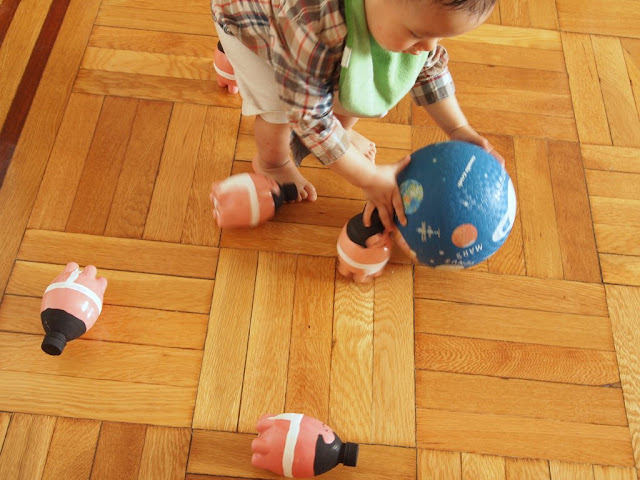 boy playing with DIY sumo wrestler bowling pins