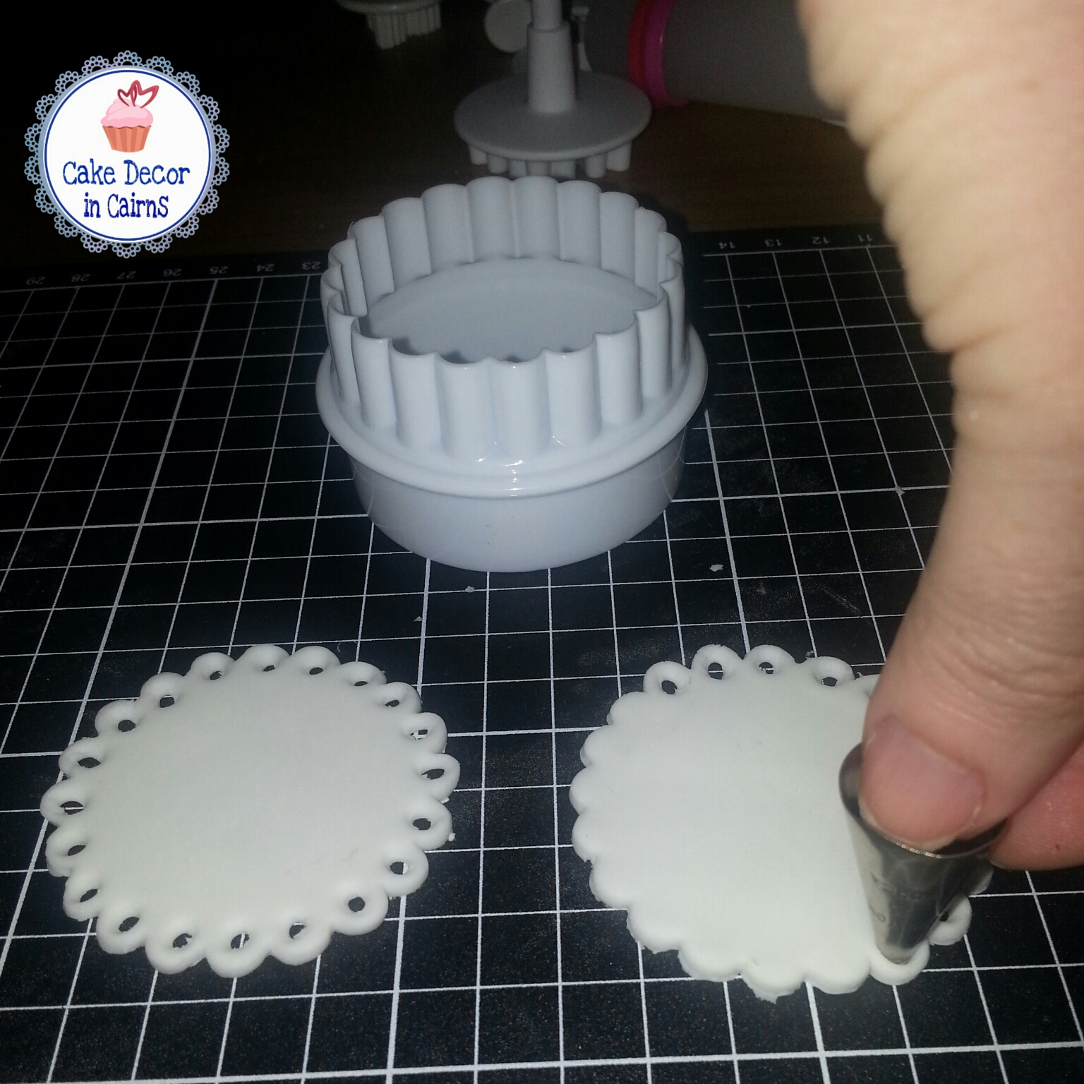 Making punched out scalloped edges with fondant to make doily toppers.