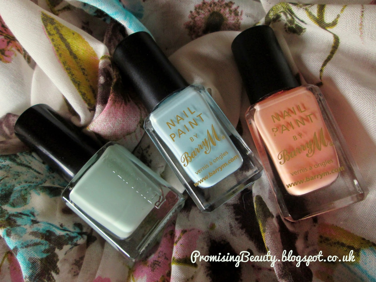 3 nail polishes in pastel shades of mint green, light blue and peach orange. Make-up revolution Cool Days, Barry M blue Moon and Peach Melba nail polishes.
