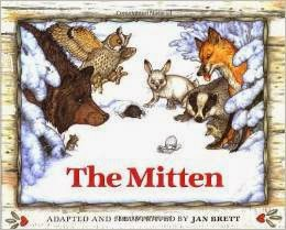 image On Canadian Freebies - The Mitten by Jan Brett cover shows animals in a snowy scene inspecting a mitten