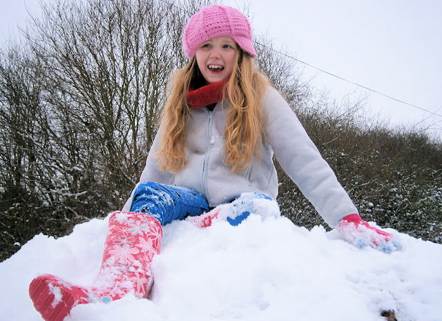 pretty girl in snow pink hat beautiful snow uk