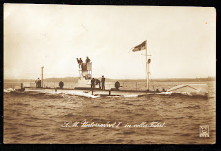 Image of U-1 at sea with text 'S.M Unterseeboot I in foller Fahrt