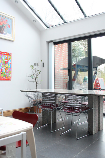 Fascinating Grey Dining Room Tables And Chairs from Iron on the Grey Stone Floor under Wide Skylights