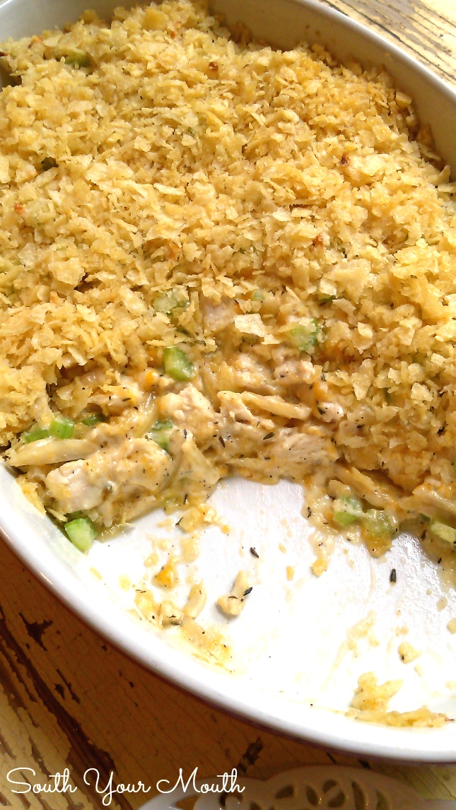 Hot Chicken Salad is made with almonds, cheese and celery topped with crushed potato chips served hot with crackers.