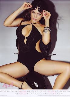 Kelly Brook sexy in  a black swimsuit
