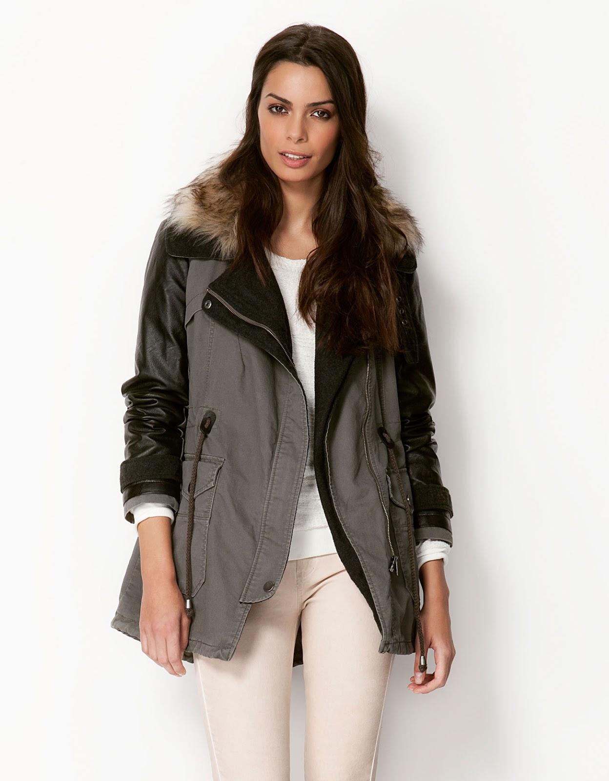 Abrigo gris con mangas de cuero