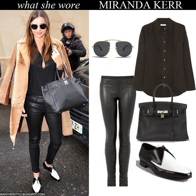 Miranda Kerr in camel coat with black shirt, black leather Helmut Lang pants, white and black Oxfords, black Birkin bag and black Prada sunglasses Want Her Style