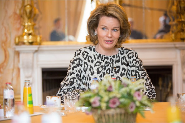 Belgian State Secretary for Poverty, Fraud and Science Elke Sleurs and Queen Mathilde of Belgium attends a presentation on poverty at the Royal Palace