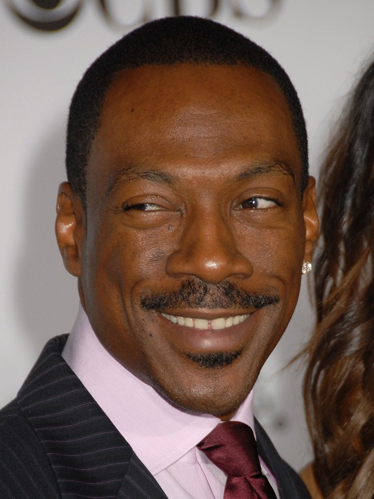 Eddie Murphy's girlfriend Paige Butcher hits the beach with his daughter Bria