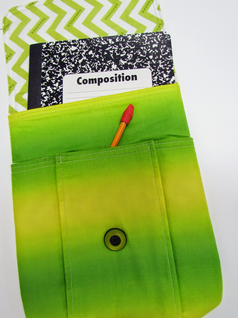 Idea Pouch holds composition notebook, pens, pencils, crayons