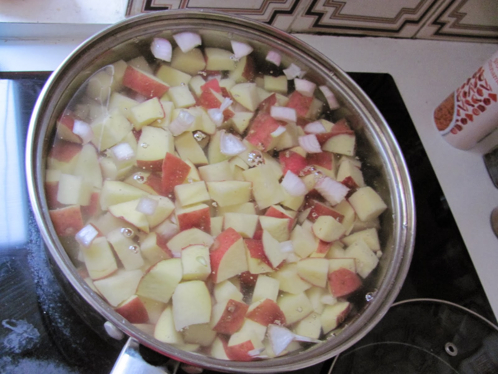 Potatoes boiling in a saucepan in Dublin Ireland Thanksgiving 2013