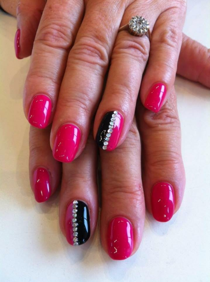 Gel back-fill then a full cover gel-color manicure in punky pink and abyss black