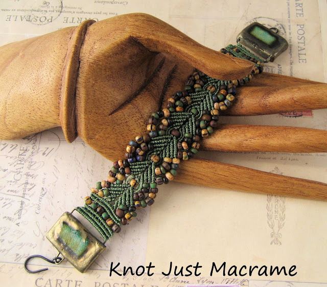 Micro Macrame bracelet with picasso czech glass beads and ceramic end pieces.
