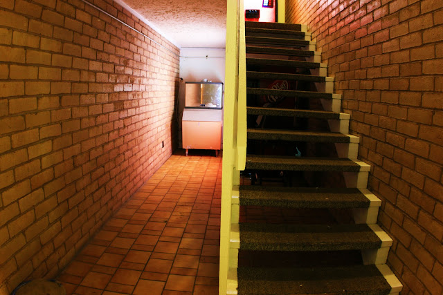 A staircase surrounded by brick at a motel in Branson, Missouri.