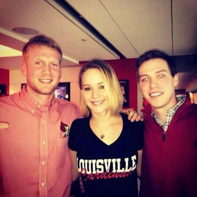 It was kind of a gloomy day at Louisville, Kentucky, USA on Saturday, December 27, 2014 as Jennifer Lawrence brightening up everyone's live with her casual look.  Finished her street style in a red hat and Jeans, the 24-year-old is always camera ready - even when it come to just cozy for the NCAA college basketball game.