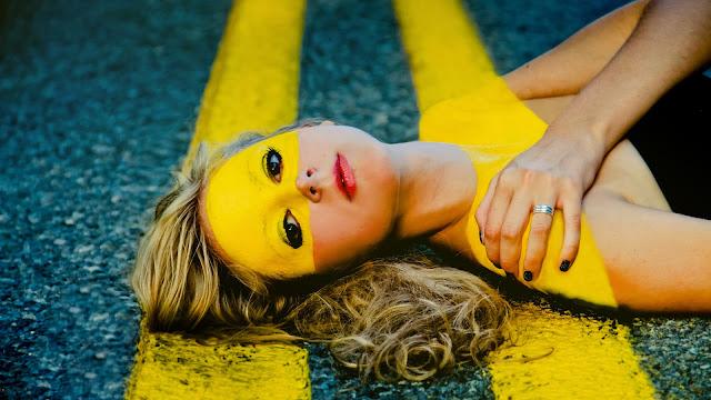 Model Lying on Road