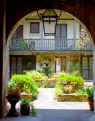 Walls of the city a look at shared courtyards for New orleans style house plans with courtyard