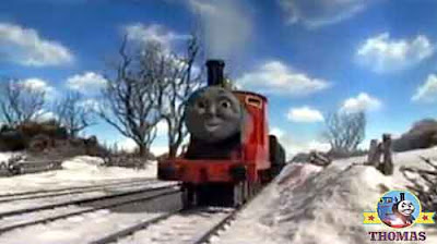 Kids big Xmas present train and James the engine pull away over the winter wonderland frost tracks