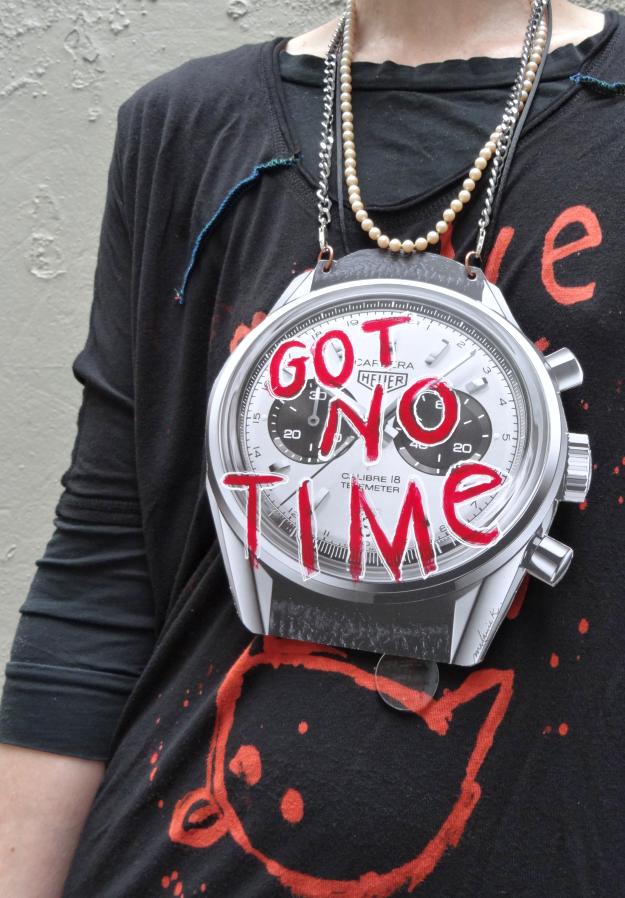 Closeup of DIY watch pendant on Bag and a Beret