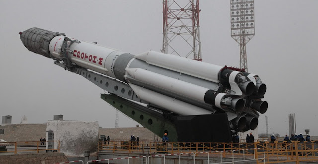 Proton-M rocket with Eutelsat 9B satellite being erected at the Baikonur Cosmodrome. Photo Credit: Khrunichev