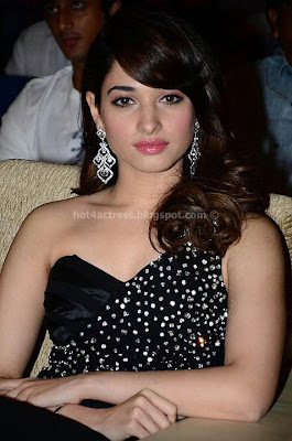 Tamanna in black dress at julayi audio launch