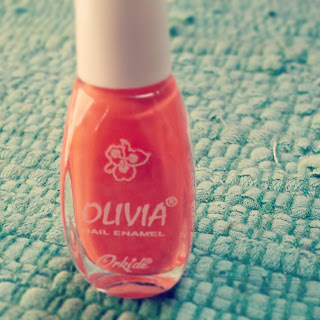 Orangefarbener Olivia Nagellack
