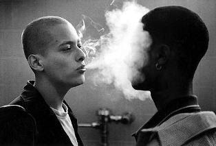 Edward Furlong as Danny Vinyard in American History X, exhales smoke at the face of a black classmate, Directed by Tony Kaye