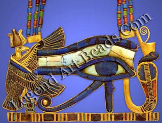 Udjal eye. Gold inlaid with glass and gemstones, suspended from necklace with gold inlaid counterweight. W. 9.5 cm. Tomb of Tutankhamun. Photograph by Egyptian Expedition, Metropolitan Museum of Art. New York.