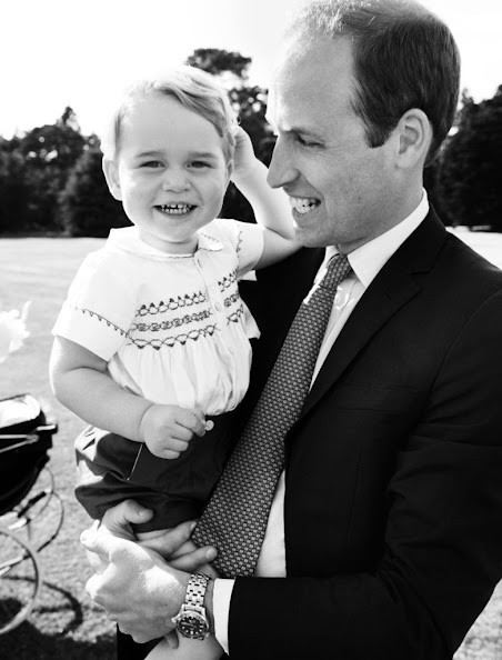 Prince William, Duke of Cambridge and his son Prince George of Cambridge pose for a photo after the christening of Princess Charlotte of Cambridge at the Sandringham Estate on July 5, 2015 in King's Lynn, England.