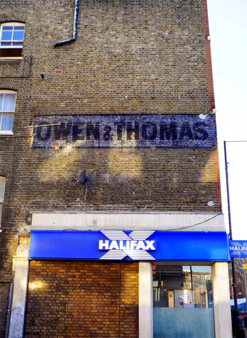 owen and thomas ghost sign bethnal green london