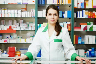 woman behind the counter of a pharmacy