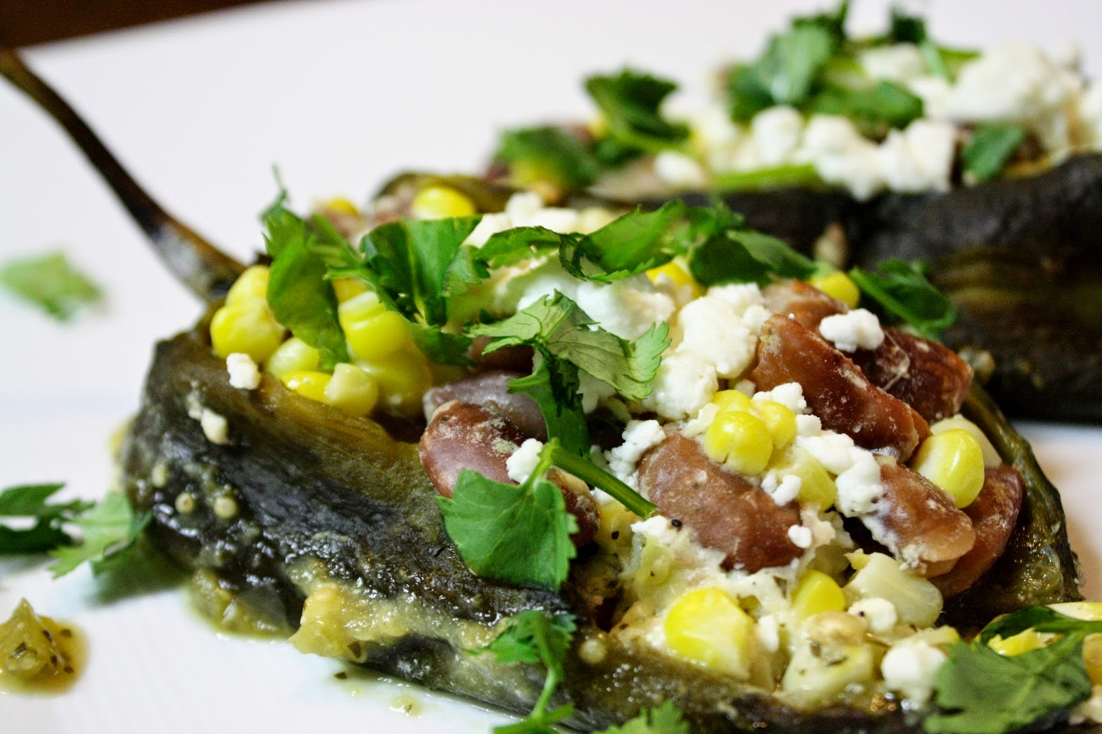 http://eatprayjuice.blogspot.com/2014/10/corn-and-bean-stuffed-poblano-chilies.html